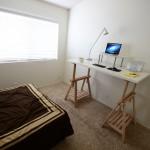 DIY Standing Desk Kit - Desk in Room with Bright Shelf